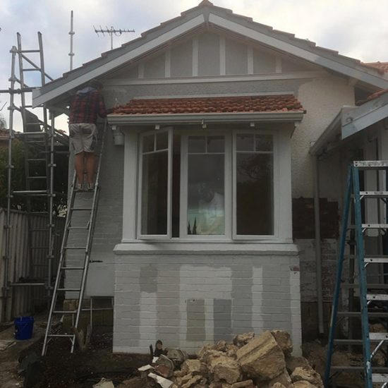 Picasso Painting exterior house painting in action grey house